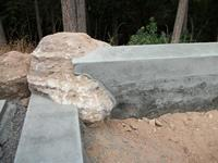Concrete bench using native bolders