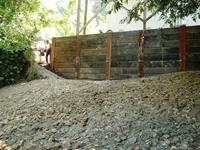 Wood bulkhead retaining wall with steel I-Beams built in Ross