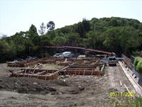 This is a foundation for one house, look big, you're right.  This large foundation is being completed for a new house that is being built in Novato, Marin County.